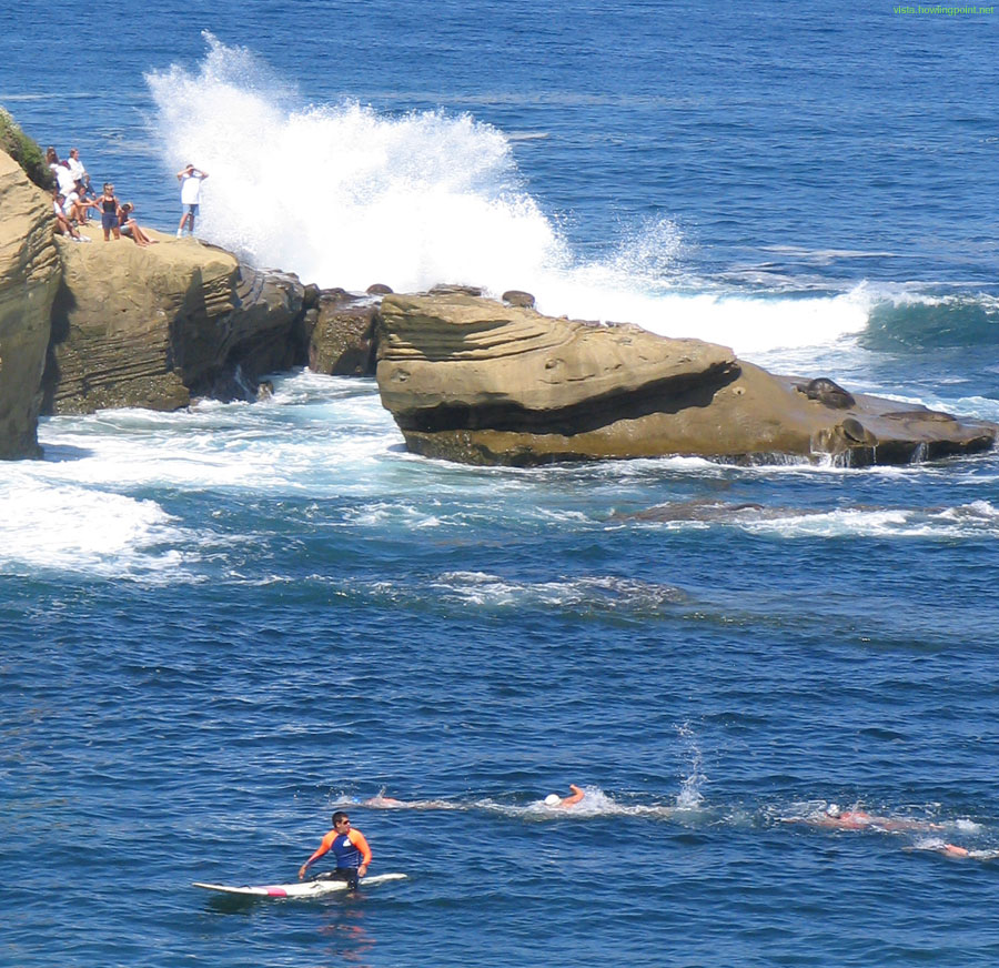 Everyone gets wet: Swimmers aren't the only ones to get drenched when the swells grow in normally tranquil La Jolla Cove.
