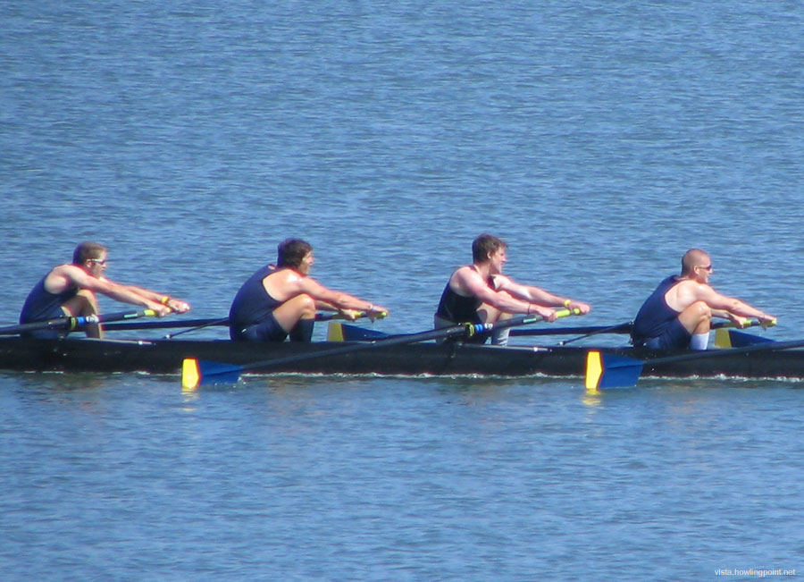 Varsity Men rowing hard: