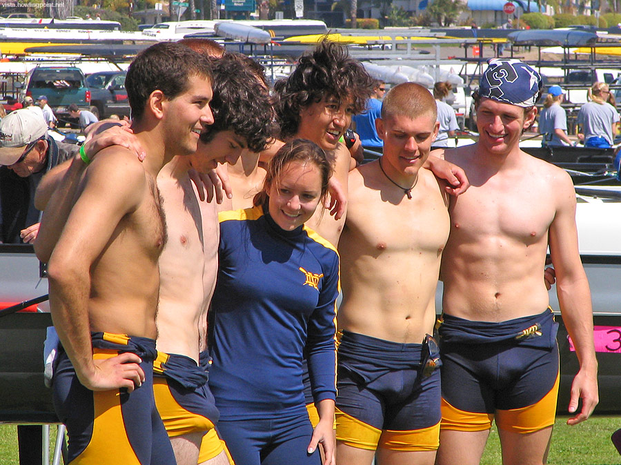 Wandering Eyes: Everyone's eyes seem to be drifting a bit as the Notre Dame crew, including their cox, pose for team photos after the morning races.