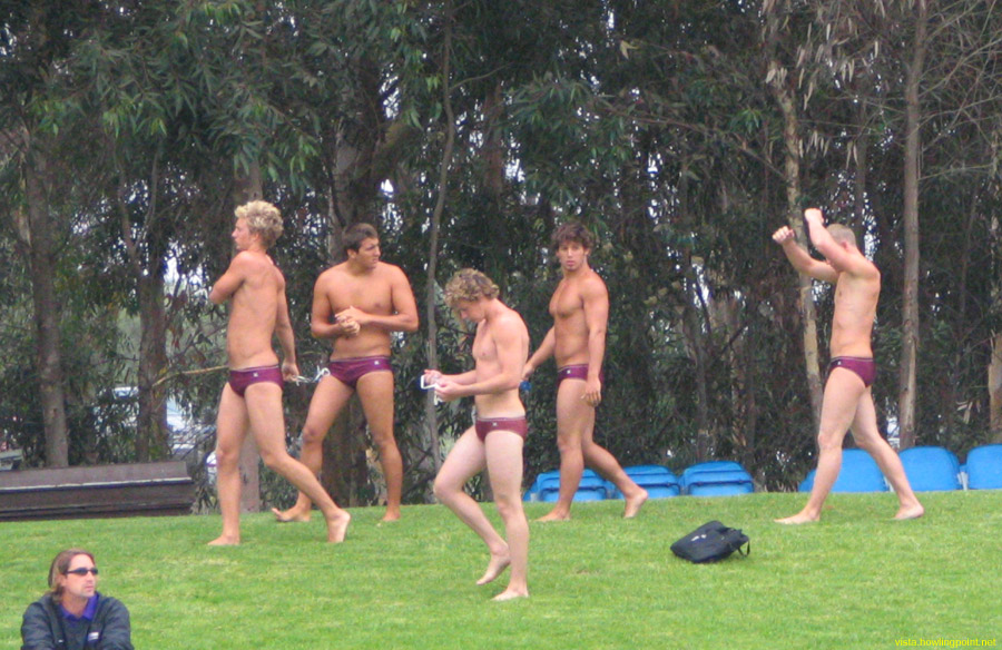 Redlands walking to the warm-up pool: Members of the Redlands men's water polo team stretching a bit while heading to the   warm-up pool before their game against Whittier.