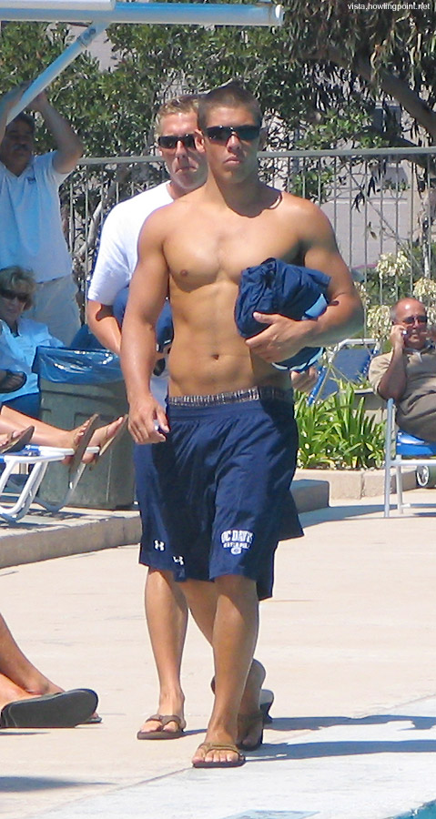 Back in clothes: UC Davis player walking on the deck of UCSD's east pool.