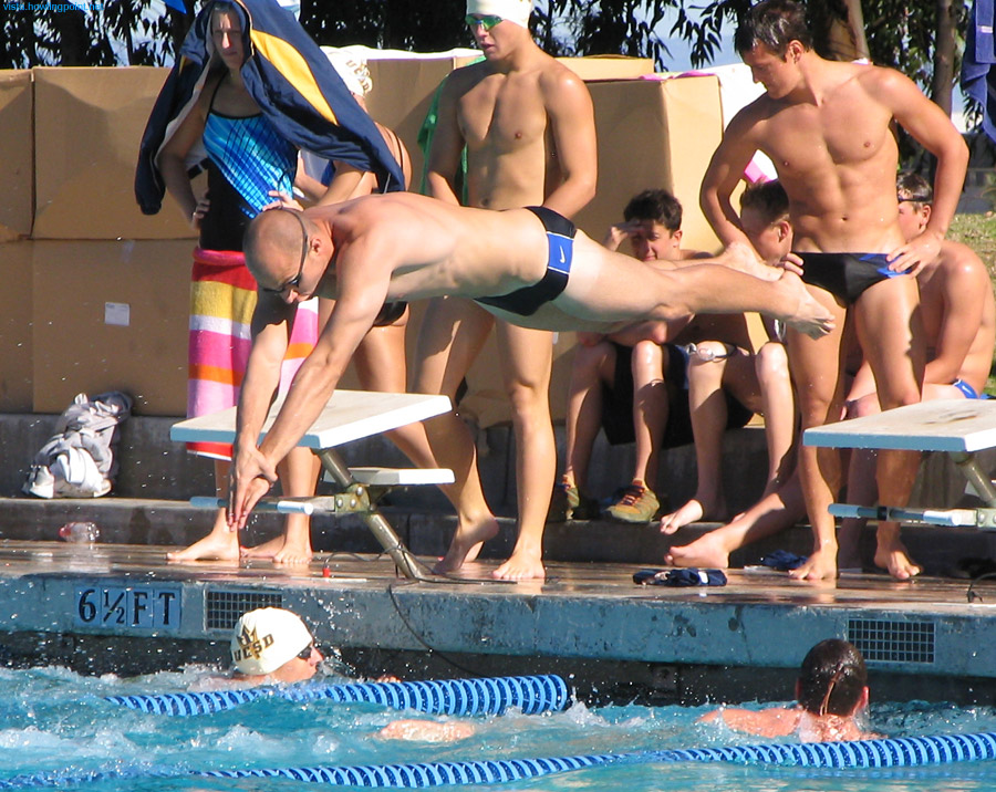 You're It: UCSD swimmer dives in during one of the men's relay races.