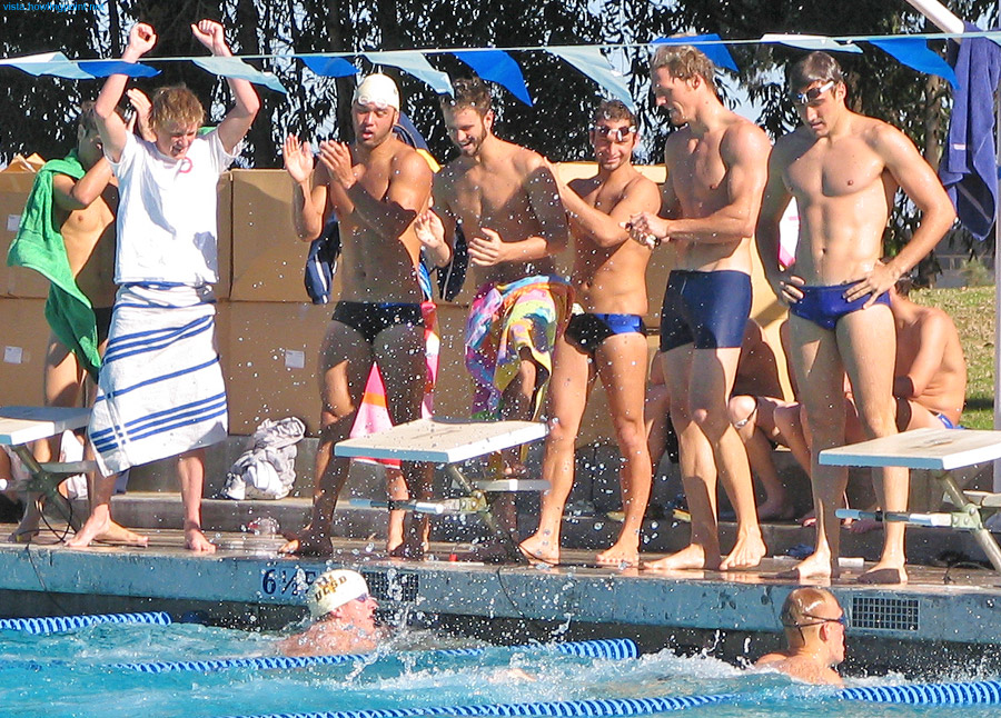 Celebrating: UCSD swimmers (left) celebrating a relay victory while Air Force swimmers to the right appear a bit more somber.