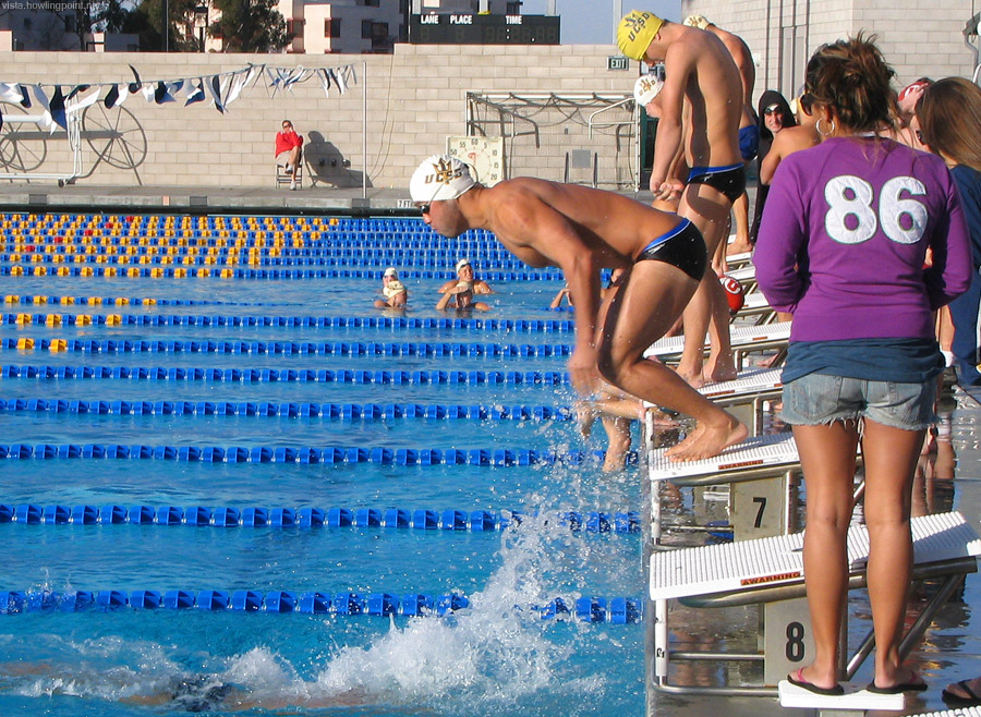 On the edge: UCSD swimmer at the tag in this 3 x 200 butterfly relay race.