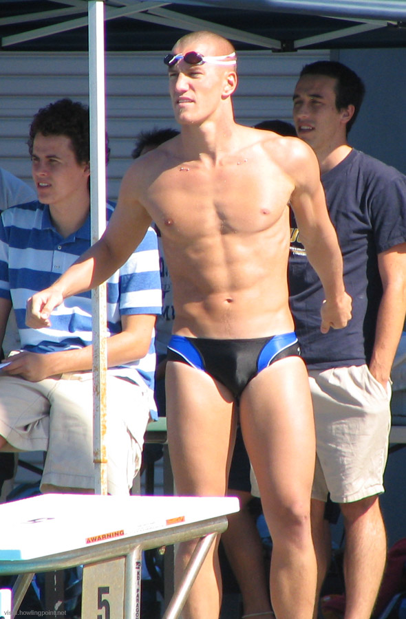 Tow cables?: UCSD swimmer on deck between heats. Note the symmetrical piercings near his collar bones.