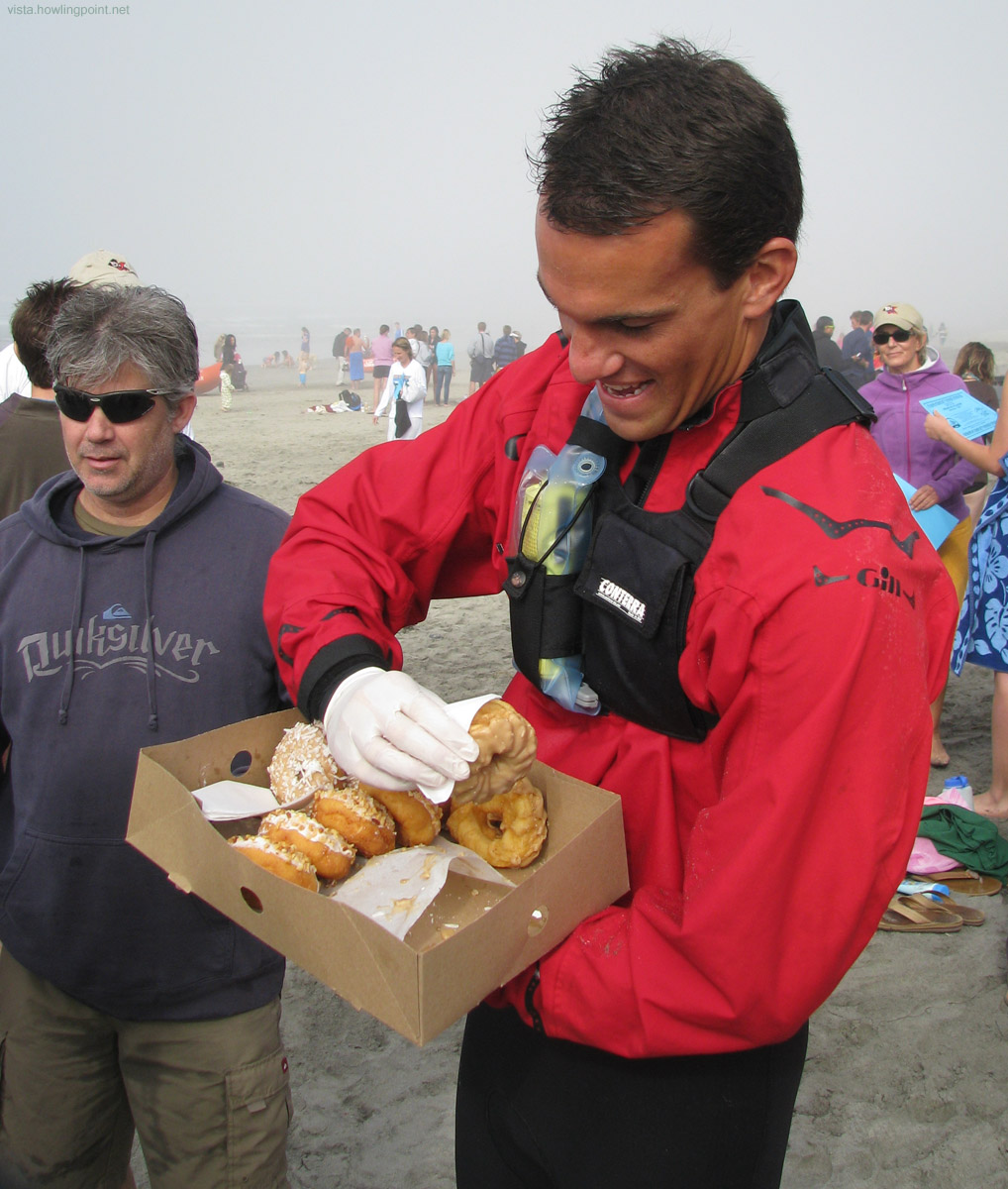 Lifeguard Serving Donuts: Mmmm, lifeguards.  Mmmm, donuts.  What better way could there be to start a New Year.
