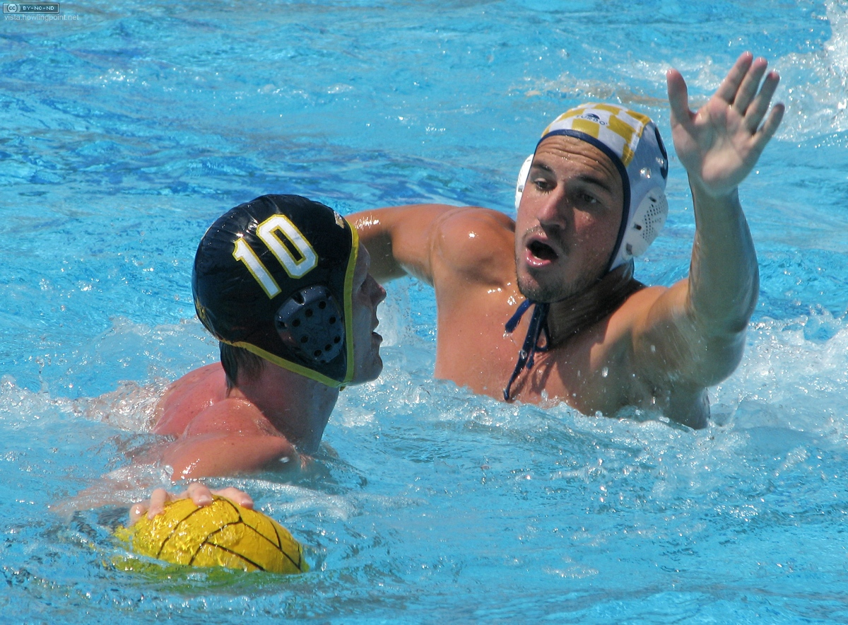 Aggressive defense: Gaucho senior Stefan Partelow (light #9) defends against Triton senior Kneif Lohse (dark #10).