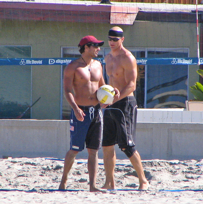 Tuesday a.m., May 23, 2006: Early morning volleyball at Mission Beach. Discussing strategy or just some nearby bikini-clad bystander?