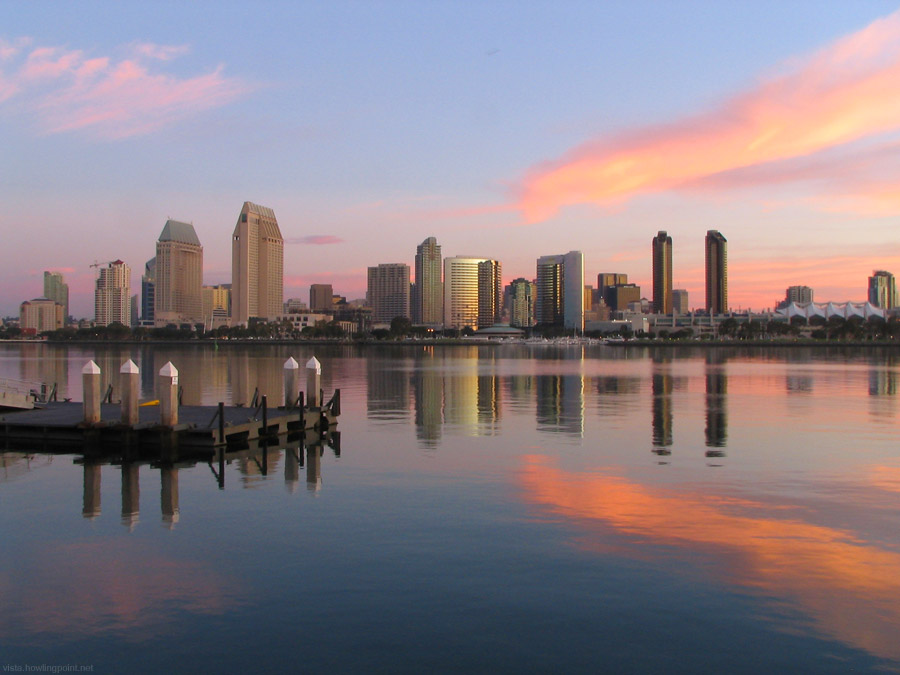 Sunday a.m. (Christmas Eve), December 24, 2006: Bright pinks and oranges are still lingering in the sky from Christmas Eve's sunrise. The San Diego skyline is the backdrop for the tranquil San Diego Bay shot from the Ferry Dock on Coronado Island