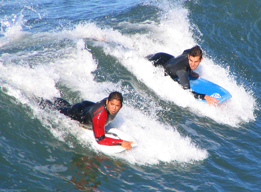 Saturday a.m., February 17, 2007: Bodyboarders north of the Oceanside Pier. These two were with a third friend and seemed to be having a great session.