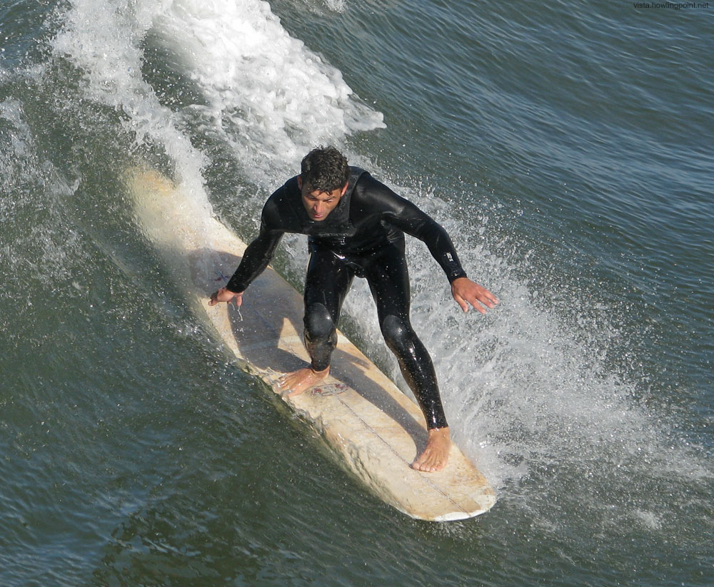 Saturday a.m., March 28, 2009: Making the most of some small surf on the north side of the Oceanside Pier.