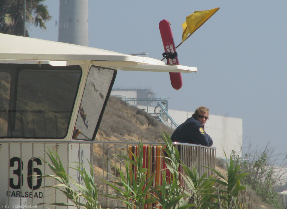 Saturday afternoon, August 28, 2010: Despite the date still indicating summer, a bit of a breeze kept even the lifeguard under an extra layer of clothes at Carlsbad City Beach.