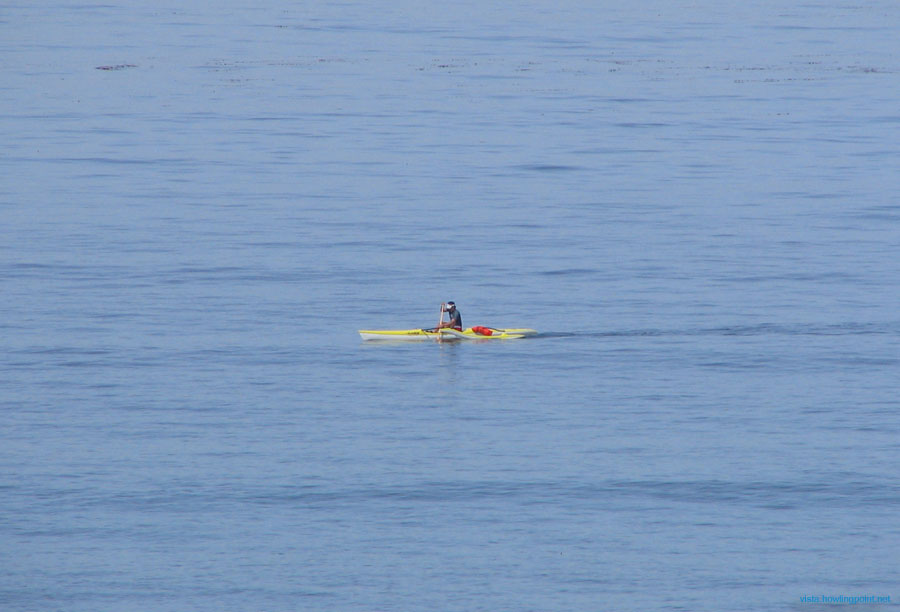 Easter morning tranquilty: Kayaker off the coast of Carlsbad's Frazee beach at about 9:00 Easter morning. Not certain, but it may be someone from the lifeguard station.