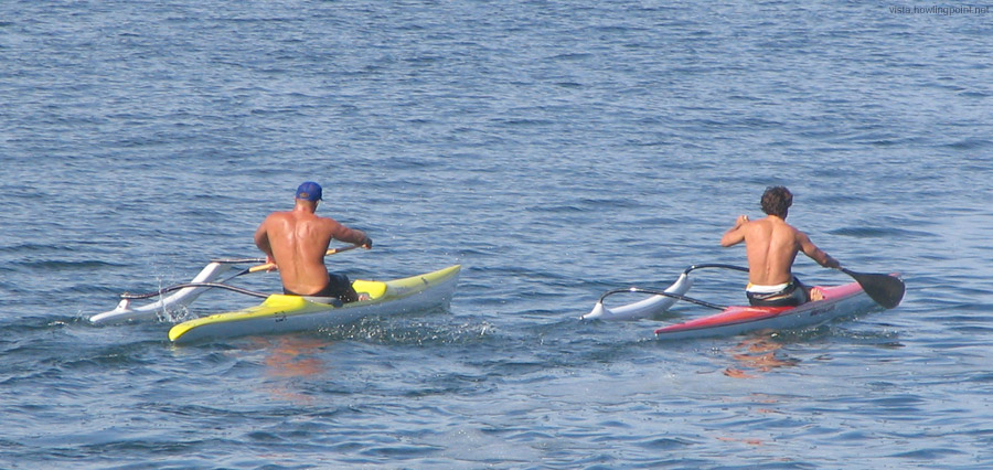 Friday a.m. (Good Friday), April 14, 2006: Outrigger   kayaks paddling out to sea via the Mission Bay Channel.