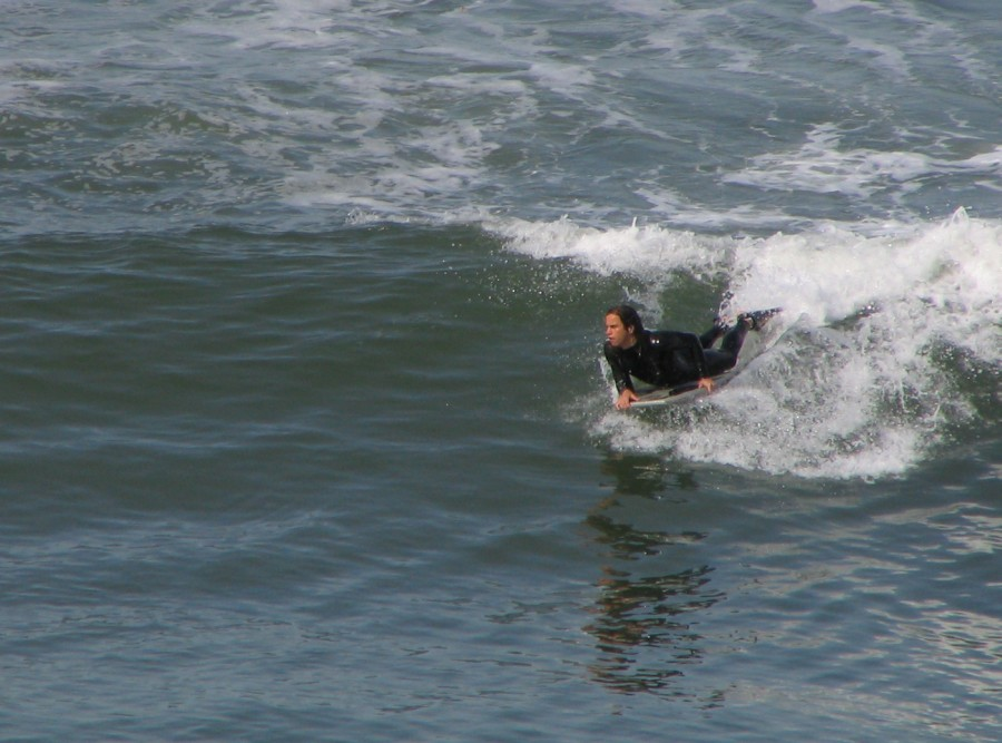 Body boarding at Carlsbad: I shot this picture of the body boarder on Easter morning 2005 at Carlsbad, CA.