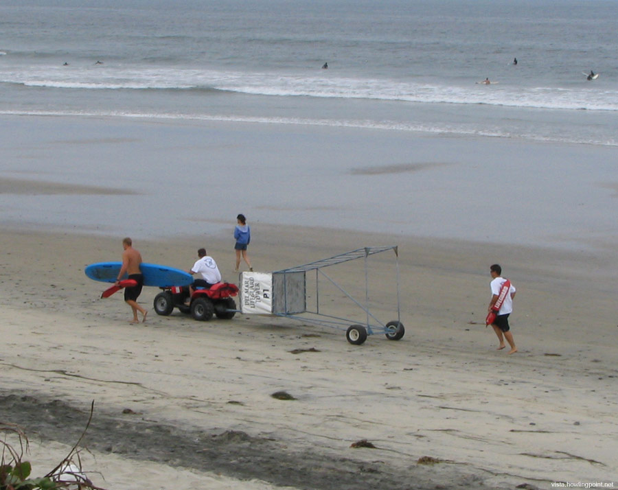 Prepping for a busy weekend: Del Mar lifeguards moving one of their temporary towers into position early on the   Sunday of Memorial Day weekend.