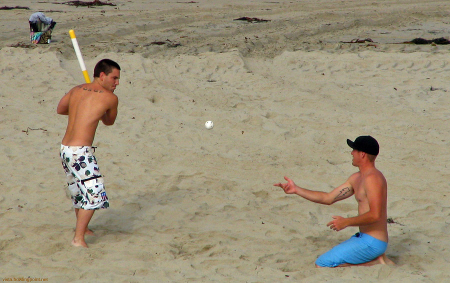 Taking a swing: A game of Over The Line on Pacific Beach on Independence Day.