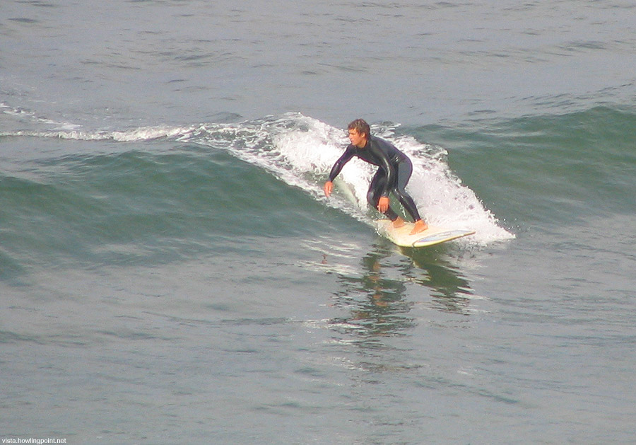 Peaceful ride: Surfer near Del Mar's (San Diego county) 9th Street early on Saturday morning.
