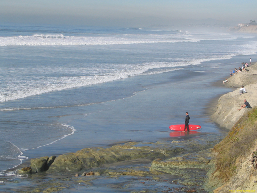Somedays its just too big.: Longboarder trying to find a safe path to paddle out through as surf hit 20 feet at Del Mar (near 15th Street).