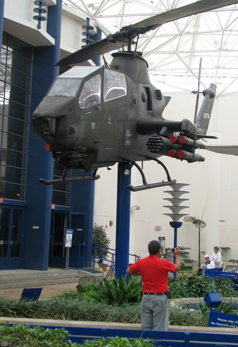 The Atrium: This helicopter, prop spinning, was one of five planes, two cars and one space capsule in the center atrium of the Air and Space Museum.