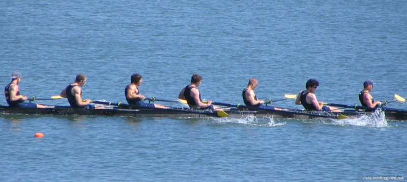Men rowing hard