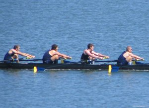 Varsity Men rowing hard